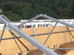 Steel constructions: roof trusses and truss bridge, Norway